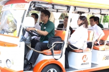 UP Diliman Chancellor Tan, Vice Chancellor for R&D Nemenzo, and Dean Matias, together with UP-EEEI junior faculty Engr. Bayona in an electric vehicle of MERALCO